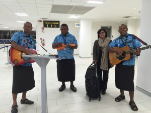 "Dr. Sania Nishtar at the airport in Fiji being welcomed by ""Serenadians"" during the WHO Director General election campaign_ 2017."